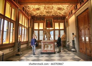 FLORENCE, ITALY - JANUARY 10, 2016: Tourists in Uffizi Gallery, one of the main museums in Florence, and among the oldest and most famous art museums of Europe, Florence, Italy