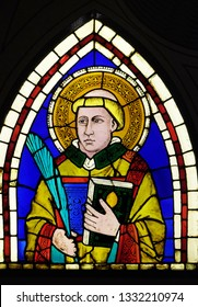 FLORENCE, ITALY - JANUARY 10, 2019: Saint Deacon the Martyr,stained glass window designed by Giotto di Bondone  in the Basilica di Santa Croce (Basilica of the Holy Cross) in Florence