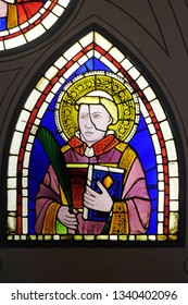 FLORENCE, ITALY - JANUARY 10, 2019: Saint Deacon the Martyr, stained-glass window designed by  Giotto di Bondone dated from the early 14th century in the Basilica di Santa Croce in Florence
