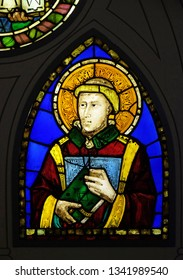 FLORENCE, ITALY - JANUARY 10, 2019: Deacon stained glass window by Pacino di Buonaguida in the Basilica di Santa Croce (Basilica of the Holy Cross) - famous Franciscan church in Florence, Italy