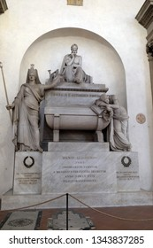 FLORENCE, ITALY - JANUARY 10, 2019: Marble cenotaph to Italian medieval poet Dante Alighieri designed by Italian Neoclassical sculptor Stefano Ricci, Basilica of Santa Croce in Florence, Italy.