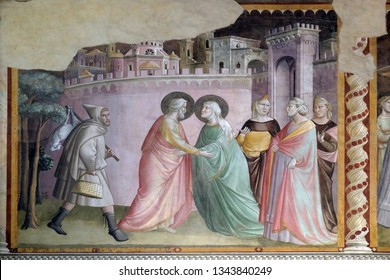 FLORENCE, ITALY - JANUARY 10, 2019: Meeting at the Golden Gate, fresco by Taddeo Gaddi (1295-1366), Bandini Baroncelli Chapel in the Basilica di Santa Croce (Basilica of the Holy Cross) in Florence