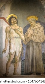 FLORENCE, ITALY - JANUARY 10, 2019: Saint John the Baptist and Saint Francis of Assisi, fresco by Domenico Veneziano, Basilica di Santa Croce (Basilica of the Holy Cross) in Florence, Italy
