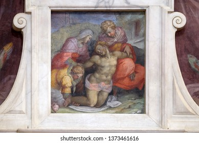 FLORENCE, ITALY - JANUARY 10, 2019: The tomb of Michelangelo (detail). Pieta fresco by Giovanni Battista Naldini, Basilica of Santa Croce (Basilica of the Holy Cross) in Florence, Italy.