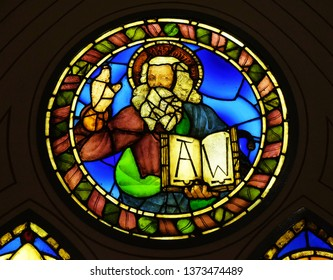 FLORENCE, ITALY - JANUARY 10, 2019: God the Father, stained glass window by Alesso Baldovinetti in the Basilica di Santa Croce (Basilica of the Holy Cross) - famous Franciscan church in Florence