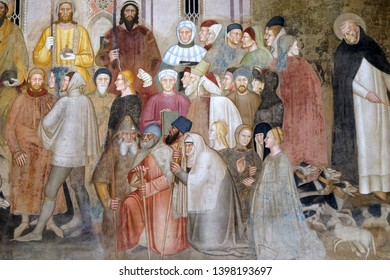 FLORENCE, ITALY - JANUARY 10, 2019: Figures of clergy and laity, detail of the Active and Triumphant Church, fresco by Andrea Di Bonaiuto, Spanish Chapel in Santa Maria Novella church in Florence