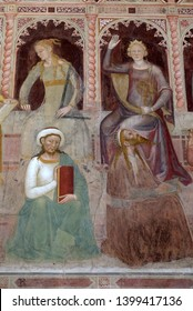FLORENCE, ITALY - JANUARY 10, 2019: Geometry-Euclid, Astronomy-Ptolemy, Sacred Sciences and Liberal arts, detail of the Triumph of St. Thomas Aquinas,  Santa Maria Novella Dominican church in Florence
