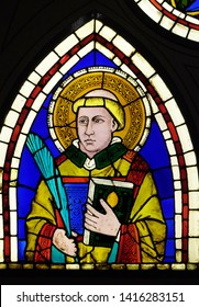 FLORENCE, ITALY - JANUARY 10, 2019: Saint Deacon the Martyr, stained-glass window designed by Giotto di Bondone, Basilica di Santa Croce (Basilica of the Holy Cross) in Florence