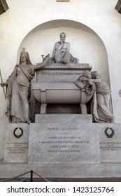 FLORENCE, ITALY - JANUARY 10, 2019: Marble cenotaph to Italian medieval poet Dante Alighieri designed by Italian Neoclassical sculptor Stefano Ricci, Basilica of Santa Croce in Florence, Italy