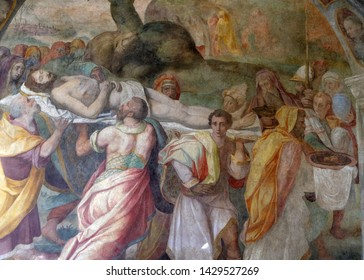 FLORENCE, ITALY - JANUARY 10, 2019: Transport of the Body of Christ, fresco by Alessandro Allori and G.M. Butteri in the cloister of Santa Maria Novella Principal Dominican church in Florence, Italy