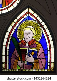 FLORENCE, ITALY - JANUARY 10, 2019: Saint Deacon the Martyr, stained-glass window by Giotto di Bondone dated from the early 14th century in the Basilica di Santa Croce in Florence