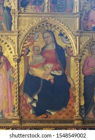 FLORENCE, ITALY - JANUARY 10, 2019: Madonna and Child (1379), by Giovanni del Biondo, Rinuccini altarpiece, Basilica di Santa Croce (Basilica of the Holy Cross) - famous Franciscan church in Florence