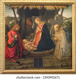 FLORENCE, ITALY - JANUARY 11, 2019: Nativity Scene with saints Julian and Francis, School of the Domenico Ghirlandaio in the Basilica di San Lorenzo in Florence, Italy