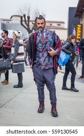 FLORENCE, ITALY - JANUARY 12, 2017 : street style during Pitti Uomo 2017 in Florence, Italy.