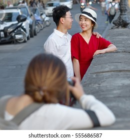 FLORENCE - ITALY, JULY 06, 2016: Photo shoot near the Ponte Vecchio with two young asian lovers, in Florence, Italy in July 06,2016