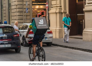 FLORENCE, ITALY - JULY 15, 2017 -    Boy on bicycle for home delivery in the center of Florence