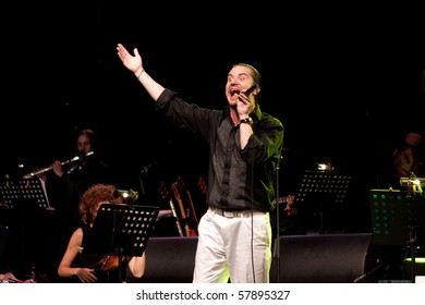 """FLORENCE, ITALY - JULY 26: Mike Patton, former Faith No More singer, performs with Orchestra Filarmonica Italiana during """"MONDO CANE"""" tour,at Fortezza da Basso on July 26, 2010 in Florence, Italy"""