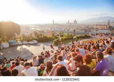 FLORENCE, ITALY - JUN 1, 2018: Tourists gather at Piazzale Michelangelo steps to enjoy spectacular sunset over Florence with Arno River, Ponte Vecchio and Florence Cathedral