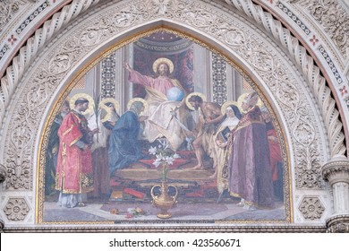 FLORENCE, ITALY - JUNE 05: Christ Enthroned with Mary and St. John the Baptist, main portal of Cattedrale di Santa Maria del Fiore, Florence, Italy on June 05, 2015