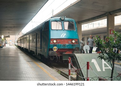 Florence, Italy - June 12, 2018 : Train arriving at Florence Santa Maria Novella (SMN) train station, main rail station in the Florence.