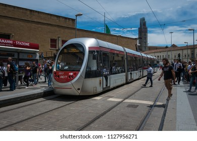 Florence, Italy - June 14, 2018 : A electric Florence  tramway arriving at platform with many passengers waiting to get on the tramway. Florentine tramway. Public transport in Florence.
