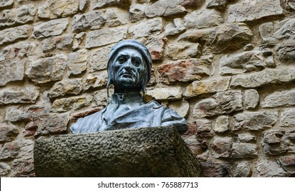 FLORENCE, ITALY - June, 2017: Bust sculpture of Dante Alighieri's head on brick wall at Dante's House in Florence, Italy.
