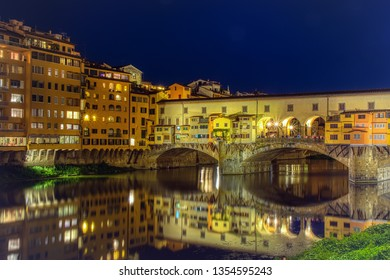 Florence, Italy - June 26, 2018: Ponte Vecchio in Florence, Italy, on a summer night. Thousands of tourists go through the bridge to day .