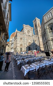 Florence, Italy - June 26, 2018: Cathedral Santa Maria del Fiore, Duomo. Italians call her Duomo. Tourists photographing the cathedral.