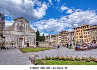Florence, Italy - June 28, 2018: Church of Santa Maria Novella in Florence, Italy. The church in Gothic Renaissance style was built between 1246 and 1360. Tourists on the square