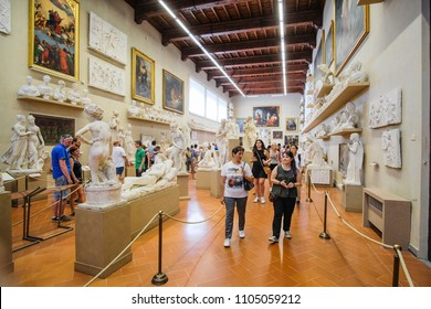 Florence, Italy - June, 3, 2018: Visitors in a museum of Florence Academy of fine arts (Accademia di belle arti di Firenze)