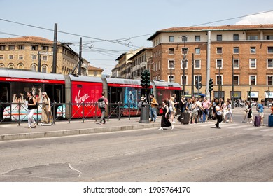 Florence, Italy, June 4, 2019: View of people crossing the road at a pedestrian crossing adjacent to tram tracks in the centre of Florence