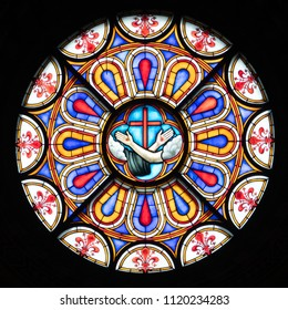Florence, Italy - June 7, 2018: A beautiful stained glass window adorns the Santa Croce Basilica in Florence, Italy.