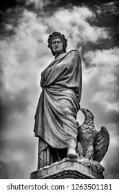 Florence, Italy - June 9, 2016:  The statue of Dante Alighieri in Santa Croce square in Florence, Italy.  In Black and White.