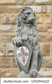 Florence, Italy - March 01, 2007: Stone Lion holding city's main symbol at Piazza della Signoria in Florence, Italy. Copy, the author of the original is Donatello.