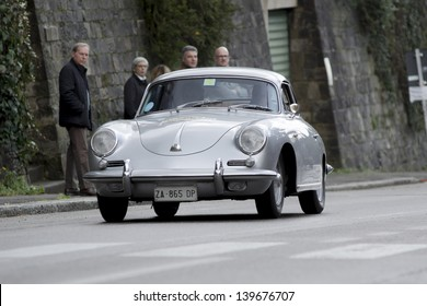 "FLORENCE, ITALY - MARCH 10: PORSCHE 356 C, (1963) during the ""Firenze-Fiesole"" race on March 10, 2013 in Florence, Italy. ""Firenze-Fiesole"" is a car race held on the streets of Florence."