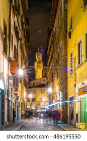 FLORENCE, ITALY, MARCH 15, 2016: tourists are strolling through a minor street in the historical center of the italian city Florence towards palazzo vecchio.