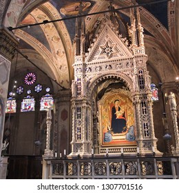 FLORENCE, ITALY - MAY 1, 2015: Interior view of Orsanmichele church in Florence, Italy. The landmark was built in 1337 and is located on Via Calzaiuoli.