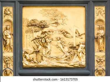 FLORENCE, ITALY - MAY 10, 2019: Lorenzo Ghiberti's Gate of Heaven, Creation of Adam and Eve, The Fall, Exile from Paradise. gate panel