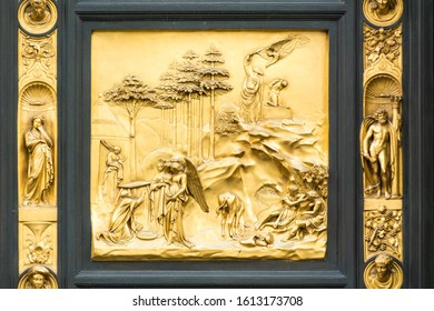 FLORENCE, ITALY - MAY 10, 2019: Lorenzo Ghiberti's Gate of Heaven. Angels are to Abraham. Isaac's Sacrifice. Angel sent by godstops Abraham's hand raised over Isaac