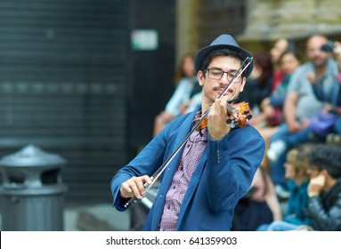 FLORENCE, ITALY, MAY 11:  Street artist playing Violin in hystoric center of Florence, Italy, in may11, 2017