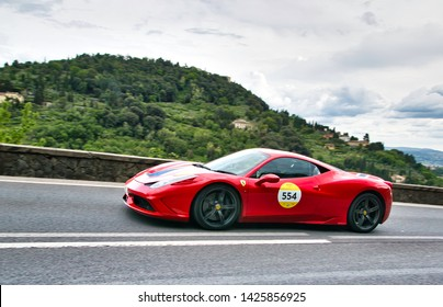 "FLORENCE, ITALY - MAY 17: Ferrari car along Via Bolognese during the 1000 miles on May 17, 2019 in Florence, Italy . ""Mille Miglia"" is a car race attempted by many celebrities"