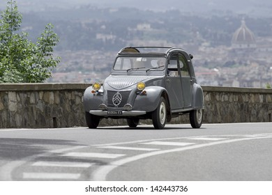 """FLORENCE, ITALY - MAY 18: Citroen 2CV during the 1000 Miles on May 18, 2013 in Florence, Italy. """"Mille Miglia"""" is a car race attended by many celebrities."""