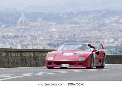 """FLORENCE, ITALY - MAY 18: Ferrari F 40 (1989) during the 1000 Miles (Ferrari Tribute) race on May 18, 2013 in Florence, Italy. """"Mille Miglia"""" is a car race attended by many celebrities."""