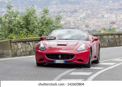 "FLORENCE, ITALY - MAY 18: Ferrari California during the 1000 Miles (Ferrari Tribute) on May 18, 2013 in Florence, Italy.  ""Mille Miglia"" is a car race attended by many celebrities."