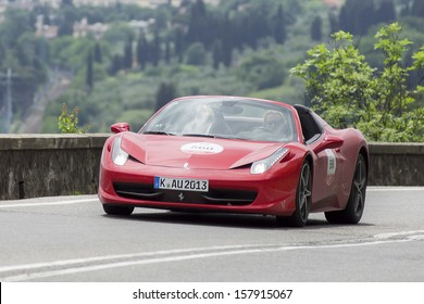 "FLORENCE, ITALY - MAY 18: Ferrari 458 Spider during the 1000 Miles on May 18, 2013 in Florence, Italy. ""Mille Miglia"" is a car race attended by many celebrities."