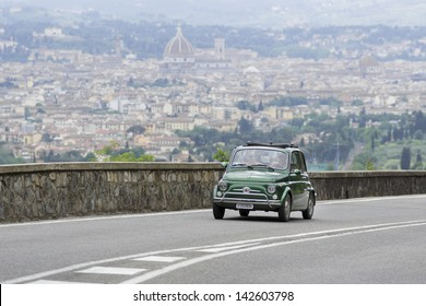 "FLORENCE, ITALY - MAY 18: Fiat 500 during the 1000 Miles on May 18, 2013 in Florence, Italy.  ""Mille Miglia"" is a car race attended by many celebrities."