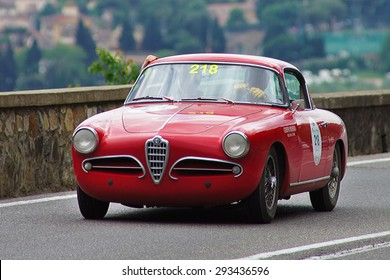 "FLORENCE, ITALY - MAY 19: Alfa Romeo Car along Via Bolognese during the 1000 miles on May 19, 2013 in Florence, Italy . ""Mille Miglia"" is a car race attempted by many celebrities"