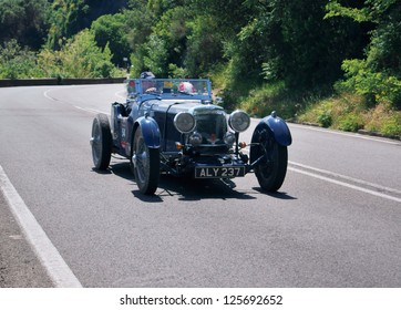 FLORENCE, ITALY - MAY 19: ASTON MARTIN Le Mans along Via Bolognese during the 1000 miles on May 19, 2012 in Florence, Italy