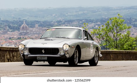 FLORENCE, ITALY - MAY 19: FERRARI 250 GT Berlinetta lusso (1963) along Via Bolognese during the 1000 miles on May 19, 2012 in Florence, Italy