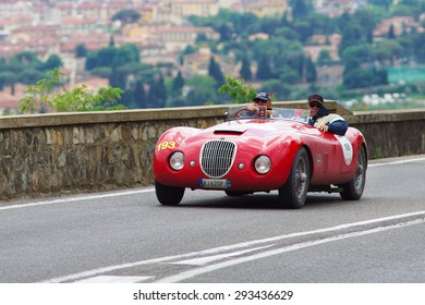"FLORENCE, ITALY - MAY 19: Old Car along Via Bolognese during the 1000 miles on May 19, 2013 in Florence, Italy . ""Mille Miglia"" is a car race attempted by many celebrities"